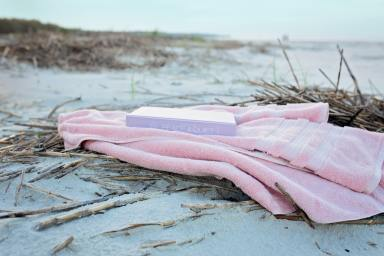 book-on-pink-textile-on-sand-during-day-2997957.jpg